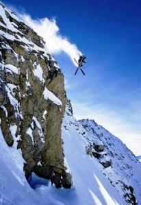 skier going over a cliff