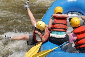 person falling out of a raft