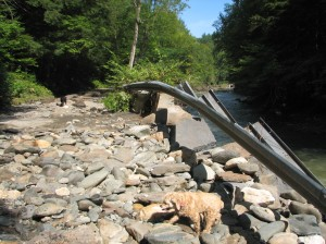 destroyed guard rail along the green river in Colrain MA